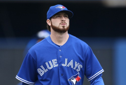 TORONTO, CANADA - JUNE 8: Drew Hutchison #36 of the Toronto Blue Jays makes his way from the bullpen to the dugout before the start of MLB game action against the St. Louis Cardinals on June 8, 2014 at Rogers Centre in Toronto, Ontario, Canada. (Photo by Tom Szczerbowski/Getty Images)